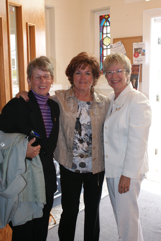 CWL - Greeters Jill Larocque and Sandra O'Toole greet Ruth O'Brien